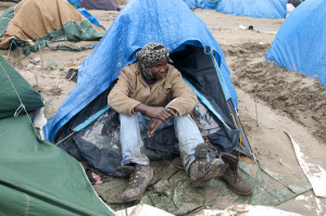 France. Refugees. Calais. So-called Jungle camp . Mohammed aged 17 from Darfur, Sudan sits by his tent