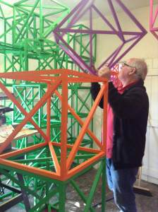Phil Holden arranging Araeens fabricated cubes_