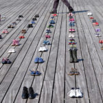 Shoes At The Water's Edge